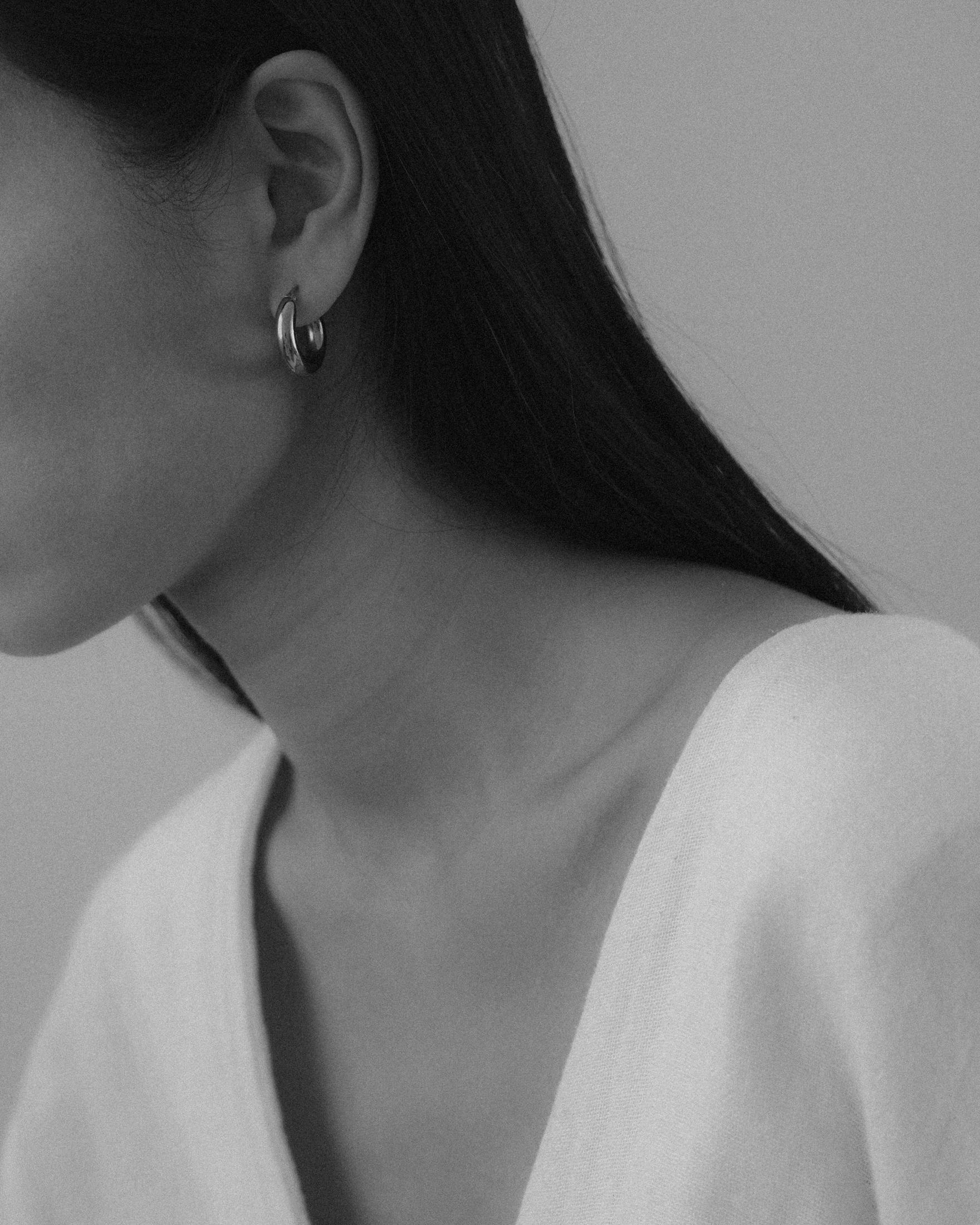 Maria Van Nguyen wearing Freja hoop earrings.