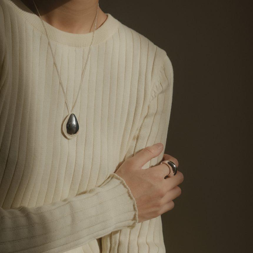 Maria Van Nguyen wearing Lunis dome necklace and Sade bold ring.